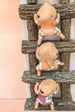 close-up,Three funny doll on a wooden ladder,process color Stock Image