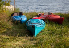 Close up of three kayaks by lake Stock Image