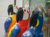 Close up of three large carved wooden macaws in rio royalty free stock photo