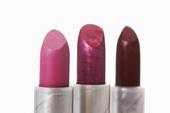 Close up of three lipsticks Royalty Free Stock Photos