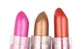 Close up of three lipsticks in different colors isolated on whit Stock Photography