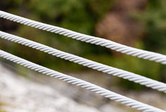 Close-up of three metal cables Royalty Free Stock Image