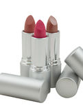 Close-up of three multicolored lipsticks Stock Photography