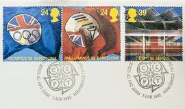 Colourful postage stamps. A close up of three postage stamps showing pictures of the Olympic Games royalty free stock photo