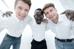 Close up.three successful young men standing together. stock photos