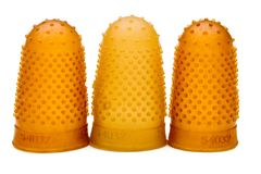 Close-Up Of Three Thimbles Stock Photo