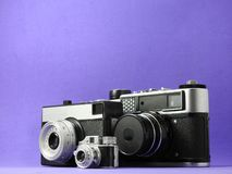 Close-up of three vintage analog photographic cameras. royalty free stock images