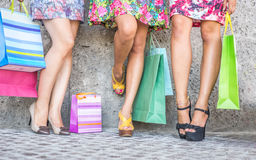 Close up of three women with shopping bags, floor view with high heels and shopping bags Royalty Free Stock Images