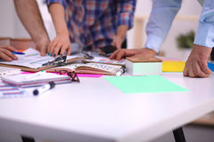 Close-up of three young creative designers working Royalty Free Stock Photo