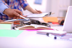 Close-up of three young creative designers working on project together. Team work Stock Images