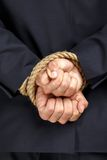 Close up of tied hands of businessman Stock Images