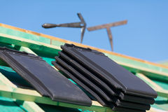 Close-up of tiles and tools on roof Stock Photos