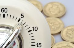 Close up of timer with coins Royalty Free Stock Photography