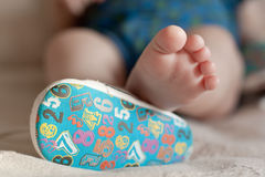 A close-up of tiny baby feet. closeup of adorable title baby shoes Royalty Free Stock Image