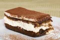 Close up tiramisu with coca powder on plate Royalty Free Stock Images