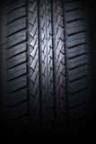 Close up tire. Close up of new tire on black background Royalty Free Stock Photography