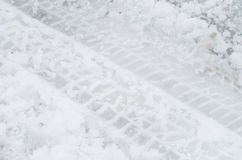 Close up of tire tracks on icy road Stock Photo