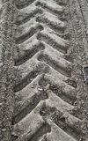 Close-up tire tracks truck on a dirt road in daylight Royalty Free Stock Photos