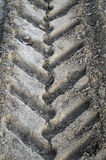 Close-up tire tracks truck on a dirt road in daylight Royalty Free Stock Photo