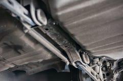 Close up tire wheel bush-bolt under double wishbone suspension car lift Stock Photos