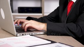 Close up tired businessman hands typing on a computer. In his office. Parallax dolly type footage stock footage