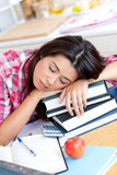 Close-up of a tired caucasian teen girl studying Stock Photo