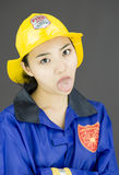 Close up of a tired lady firefighter poking out tongue Stock Photography