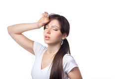 Close-up of a tired young woman over white background Stock Photo