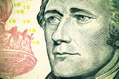 Close up to Alexander Hamilton portrait on ten dollar bill. Tone Stock Photos
