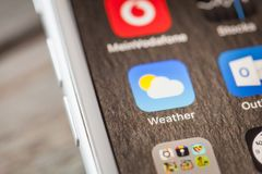 Close up to Apple weather app on iPhone 7 screen. BERLIN, GERMANY - JUNE 6, 2018: Close up to Apple built in Weather app on the screen of an iPhone 7 Plus with royalty free stock photo