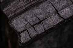 Close up to black charcoal showing texture of wood burn. Royalty Free Stock Photo
