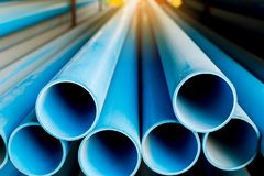 Close up to blue plastic pipe background, PVC pipes stacked in warehouse stock photos