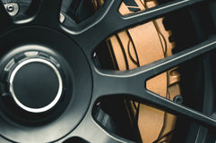 Close-up to the brake system. In a sport car stock image