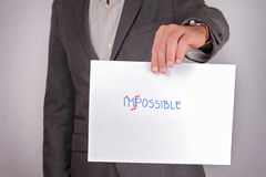 Close up to businessman hands  showing how to transform word impossible into possible . Business vision, success, team work,  lead Stock Photo