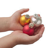 Hands with three baubles Royalty Free Stock Photography