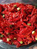 Red chilis on black background Royalty Free Stock Photo