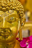 Close-up to golden buddha statue Royalty Free Stock Images