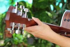 Close up to the hand of guitar player Stock Photos