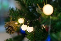 Close up to lights decorations on Christmas tree. Happy New Year and Xmas theme Stock Photography