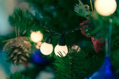Close up to lights decorations on Christmas tree. Happy New Year and Xmas theme Royalty Free Stock Photos