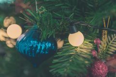Close up to lights decorations on Christmas tree. Happy New Year and Xmas theme Stock Photos