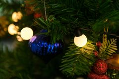 Close up to lights decorations on Christmas tree. Happy New Year and Xmas theme Royalty Free Stock Images