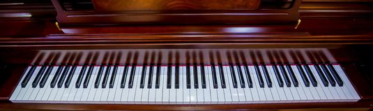 Close up to the piano keyboard background with selective focus. Top view of instrument musical tool. Close up to the piano keyboard background with selective royalty free stock photo