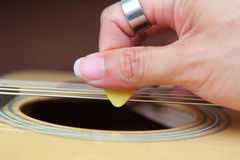 Close up to pick acoustic guitar Stock Images