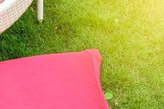 Red bean bag on the lawn. Close up to red bean bag on the lawn stock photography
