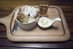 Close up toast in a cup with icing sugar powdered on top, honey in a mug shot, put on wooden plate,wooden table,morning breakfast. Honey toast menu Royalty Free Stock Image