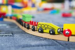 Close up of a toddlers wooden train railway set. Wooden toy train on wooden railroad.  royalty free stock images