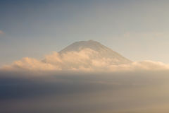 Close up tok of Mt.Fuji skyline above cloudy during sunset. Mountain fuji from lake Kawakuchi in winter season during sunset Stock Images