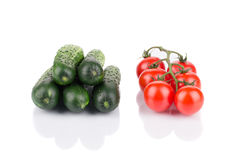 Close up of tomato and cucumber bunches. Royalty Free Stock Photo