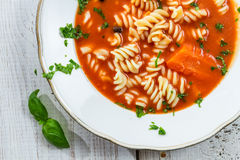 Close-up of tomato soup with basil Royalty Free Stock Photo